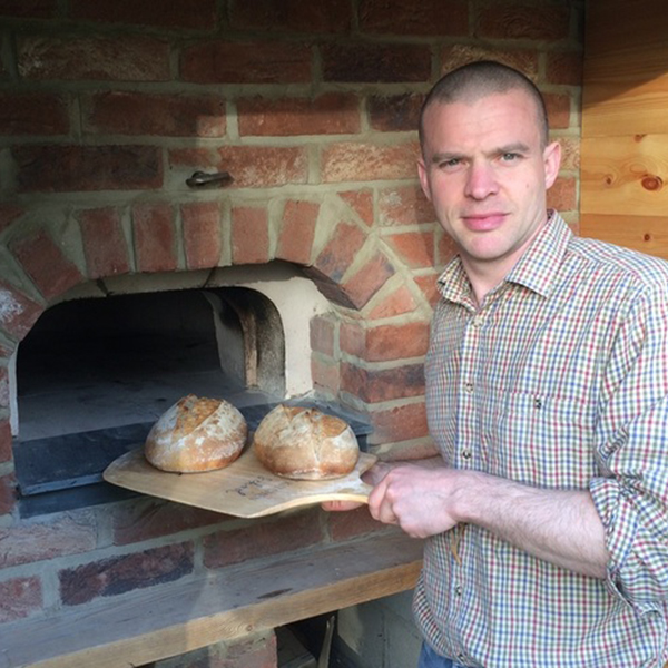 Jonathon with bread made with Prior's Flour
